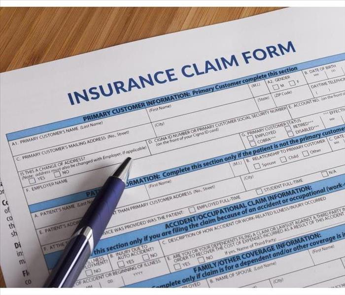 Insurance claim waiting to be filled out, pen on top of form